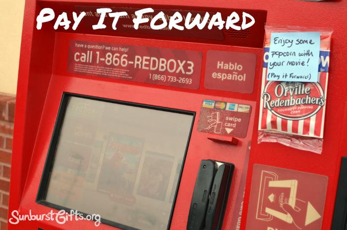 pay it forward popcorn taped to Redbox machine