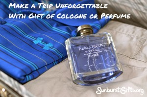 bottle of cologne in luggage on top of clothes