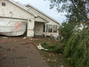 outside of house damaged by tornado
