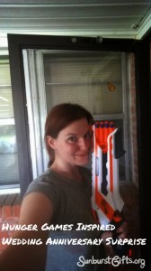 Young woman holding up Nerf toy guyn.